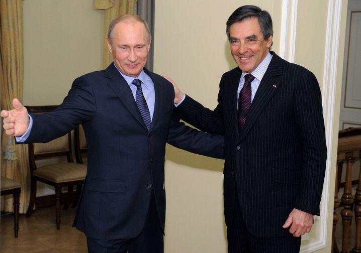 Putin und Fillon im März 2013 bei Moskau