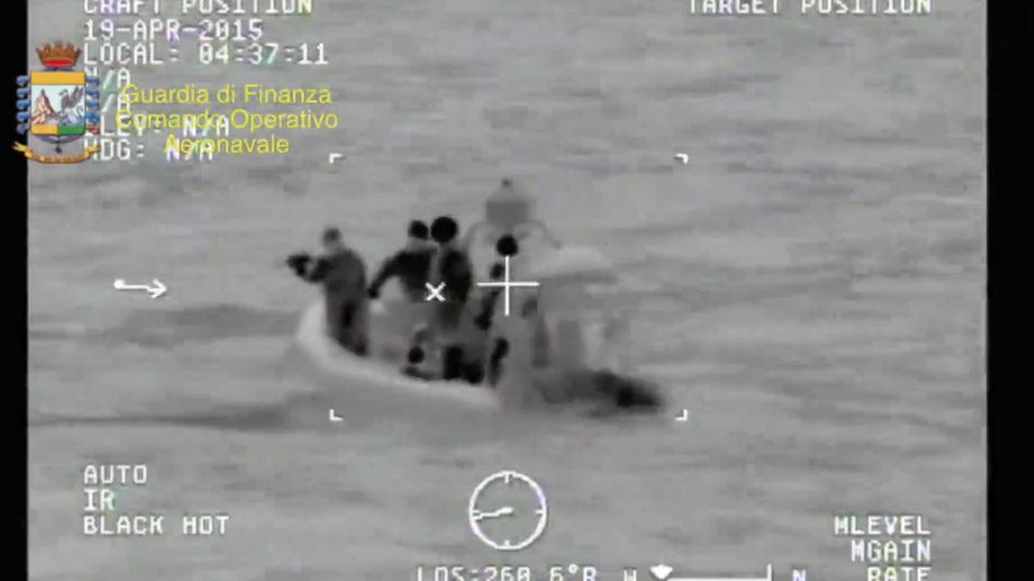 An image provided by Italy's Guardia di Finanza showing the rescuing of a refugee boat in the Mediterranean last April