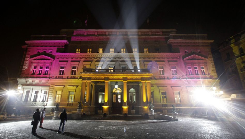 Lights illuminate city hall in Belgrade, Serbia, as Serbians celebrate the lifting of visa restrictions to EU countries.