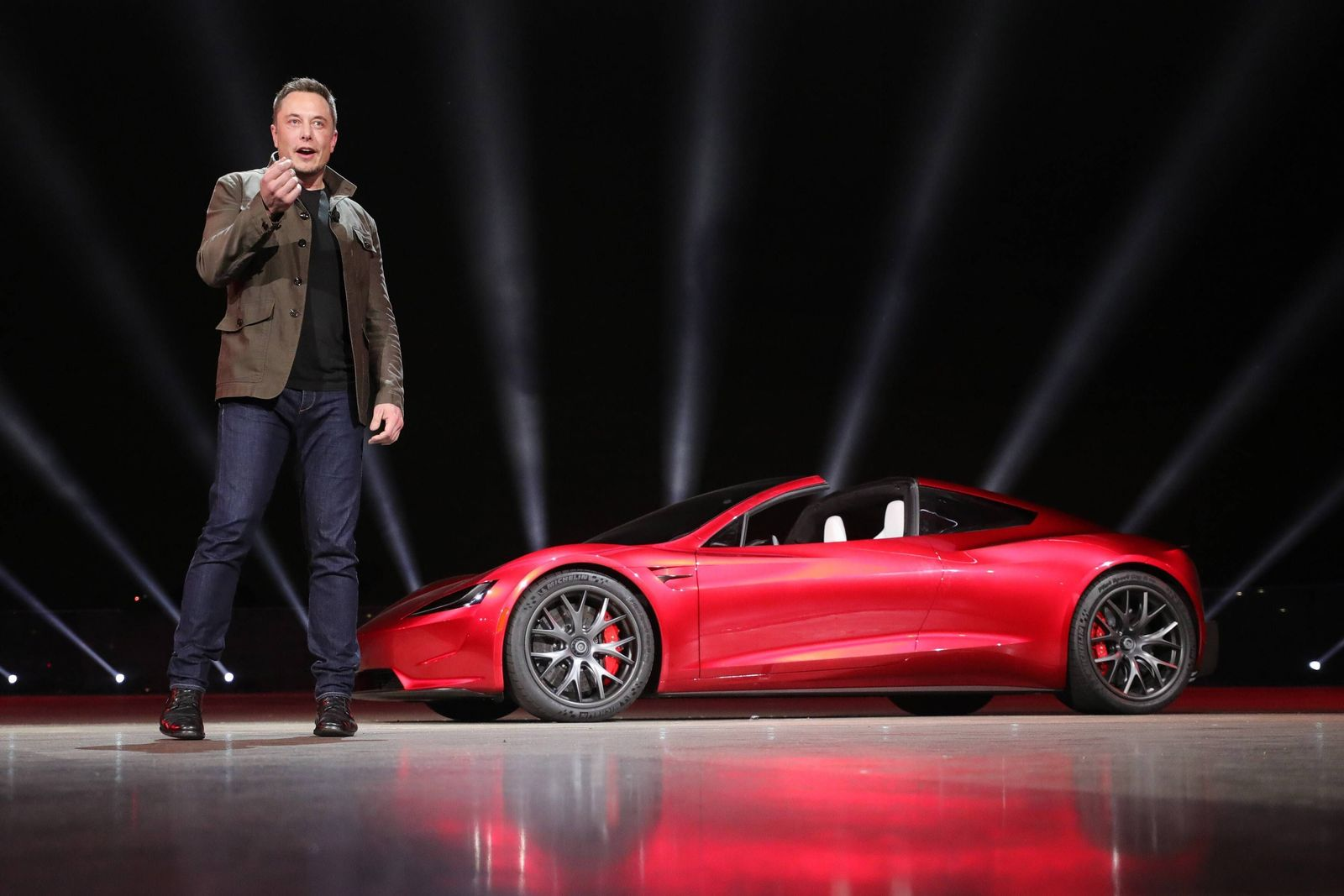 Elon Musk Chairman and CEO of Tesla unveils the company s new Roadster sports car which can go f