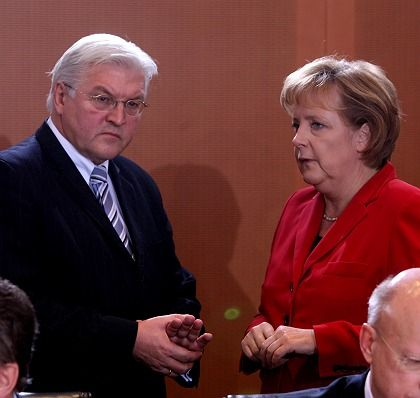 Chancellor Angela Merkel chats with Vice-Chancellor and Foreign Minister Frank-Walter Steinmeier during the weekly cabinet meeting Wednesday.