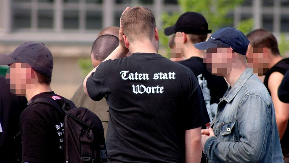 "Neo-Nazis marching in Leipzig: the T-shirt reads ""Deeds Not Words"""