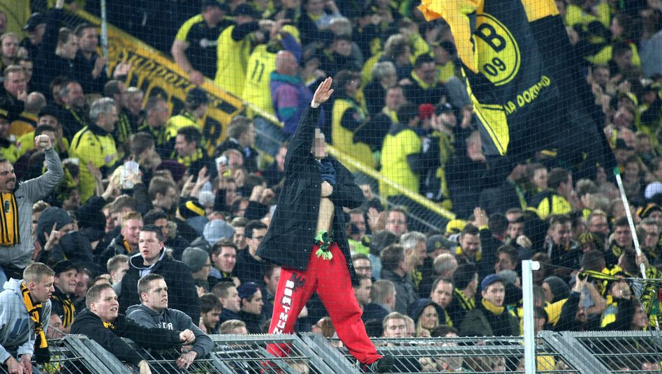 A Dortmund fan gives a Hitler salute at a game against Stuttgart
