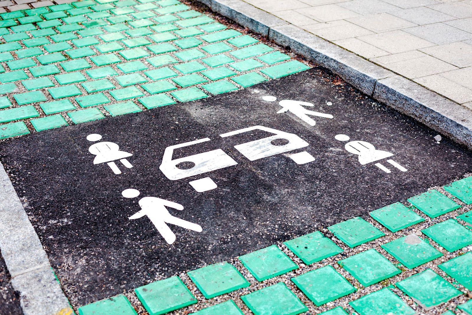 Car sharing vehicle parking sign on asphalt road