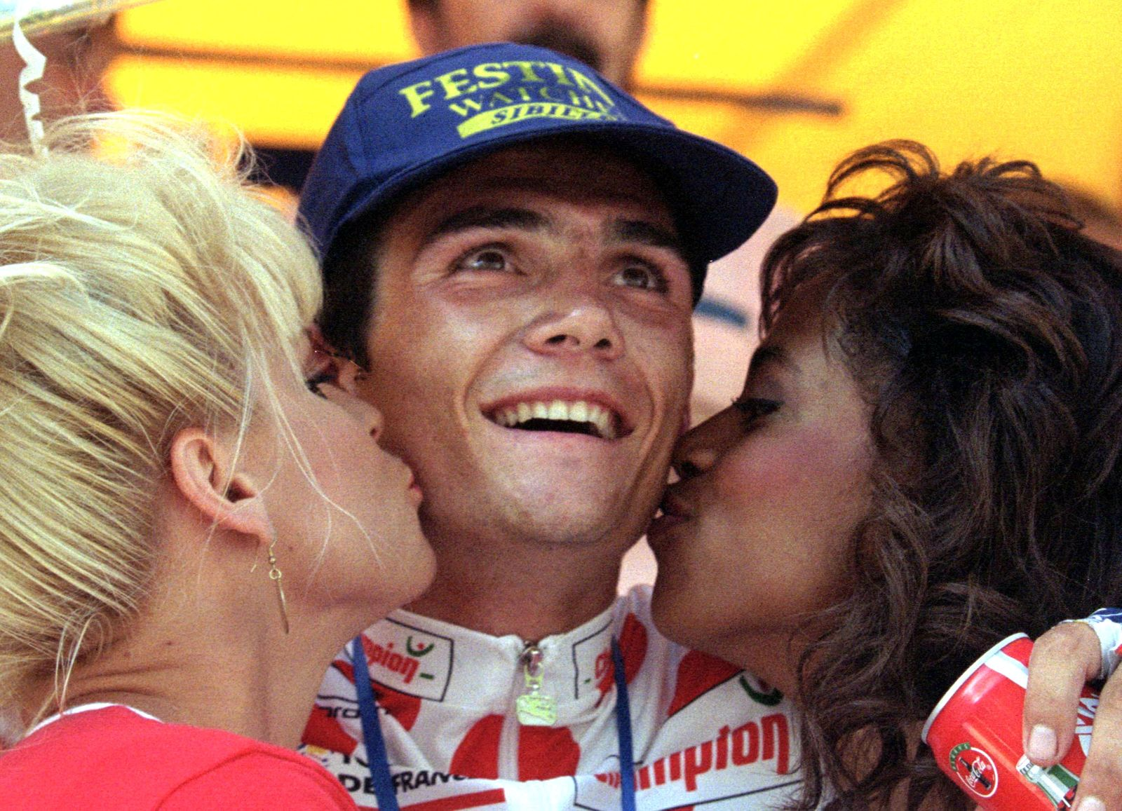 Richard Virenque of France is kissed on the podium following his solo victory in the 206km 15th stag..