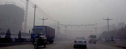 Smoke from factories in China's Shanxi province: Slowly, politicians and scientists are recognizing the path of destruction caused by China's industrial revolution.
