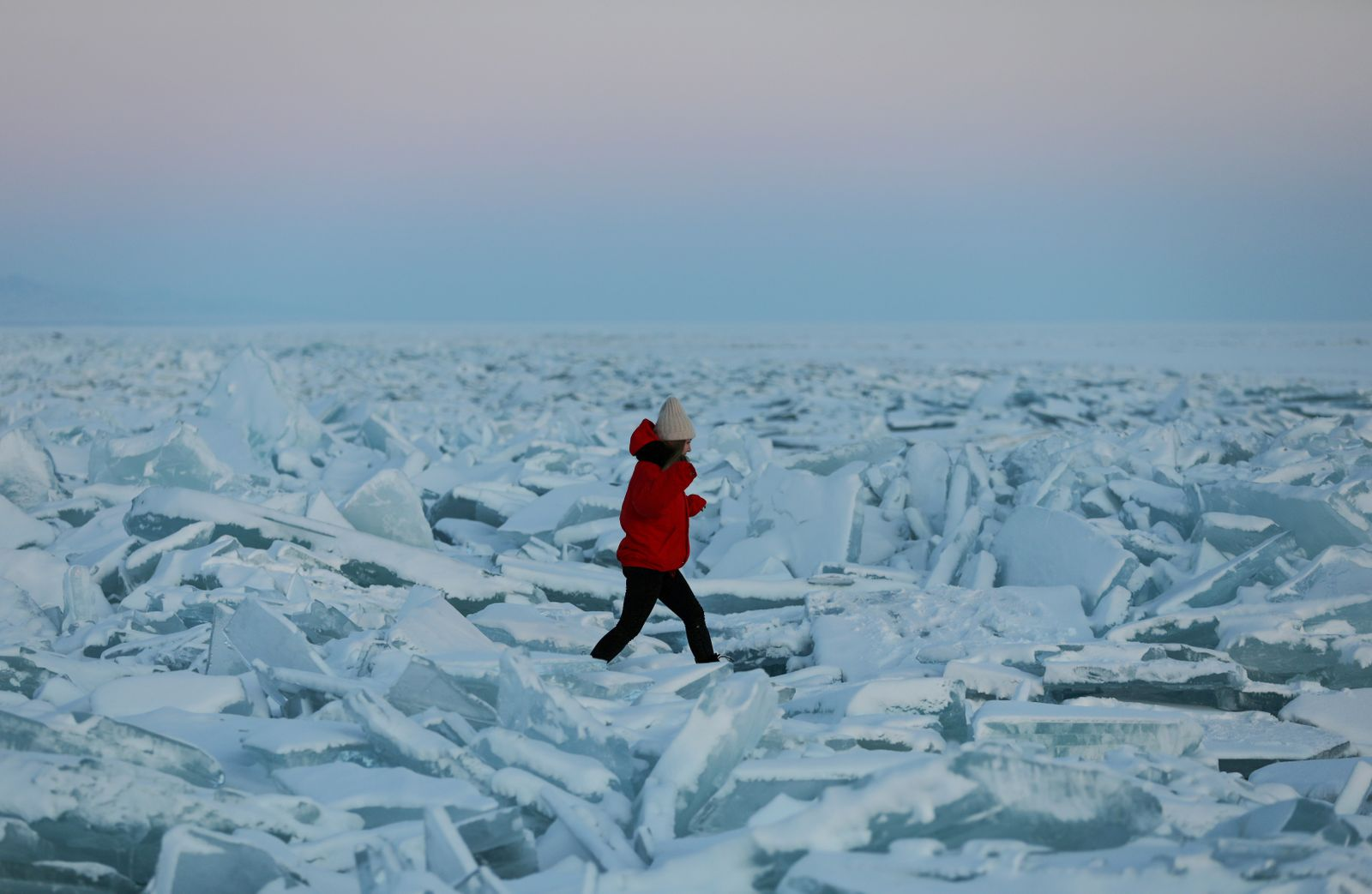 A woman walks through chunks of ice on the frozen Kapchagay reservoir outside Almaty