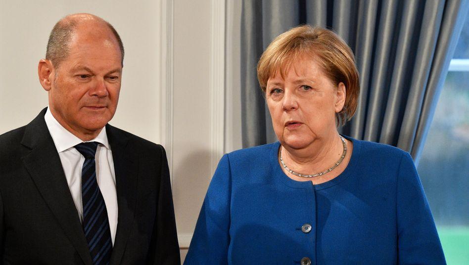 Verhandler Olaf Scholz (SPD), Angela Merkel (CDU)