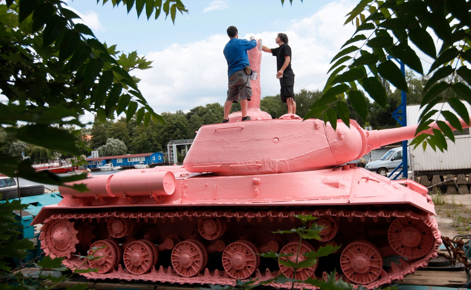 Visual artist Cerny makes final touches to a Soviet WW II tank before its transport to Prague's city center