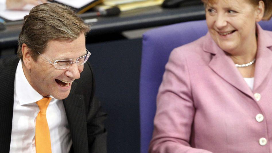 Lachender Guido Westerwelle und Angela Merkel: Gefühlslaute weltweit gleich