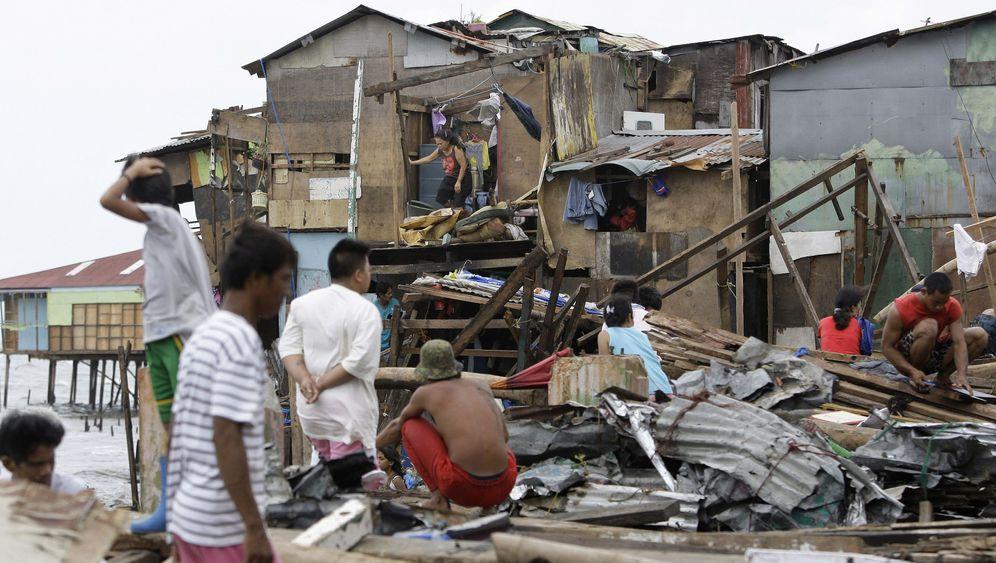 """Philippinen: Verwüstung durch """"Nesat"""" und """"Nalgae"""""""