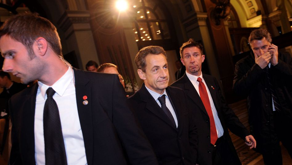 French President Nicolas Sarkozy departs a meeting on the euro on Wednesday evening.
