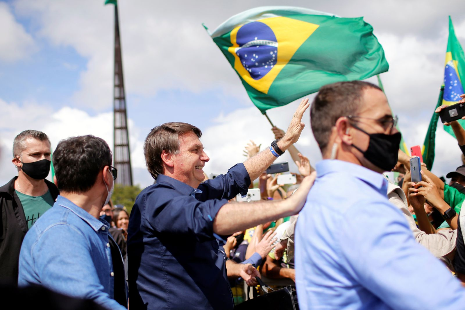 Brazil's President Jair Bolsonaro greets supporters during a protest in his favor in front of the Planalto Palace, amid the coronavirus disease (COVID-19) outbreak, in Brasilia