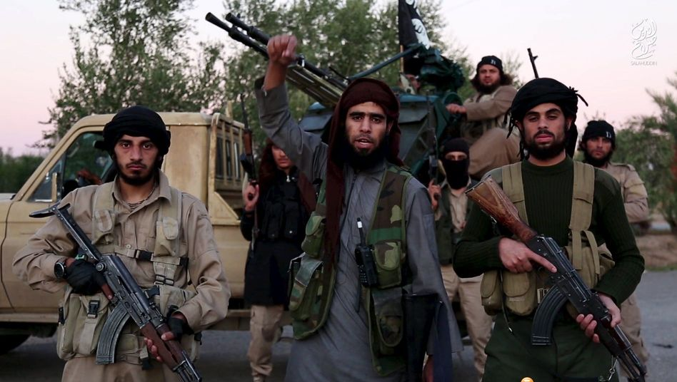 """A still from a propaganda video featuring Islamic State fighters: """"We have to prepare for a new situation."""""""
