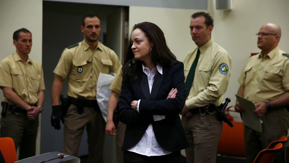 Defiant in pose: Defendant Beate Zschäpe keeps her arms cross in court on Monday.