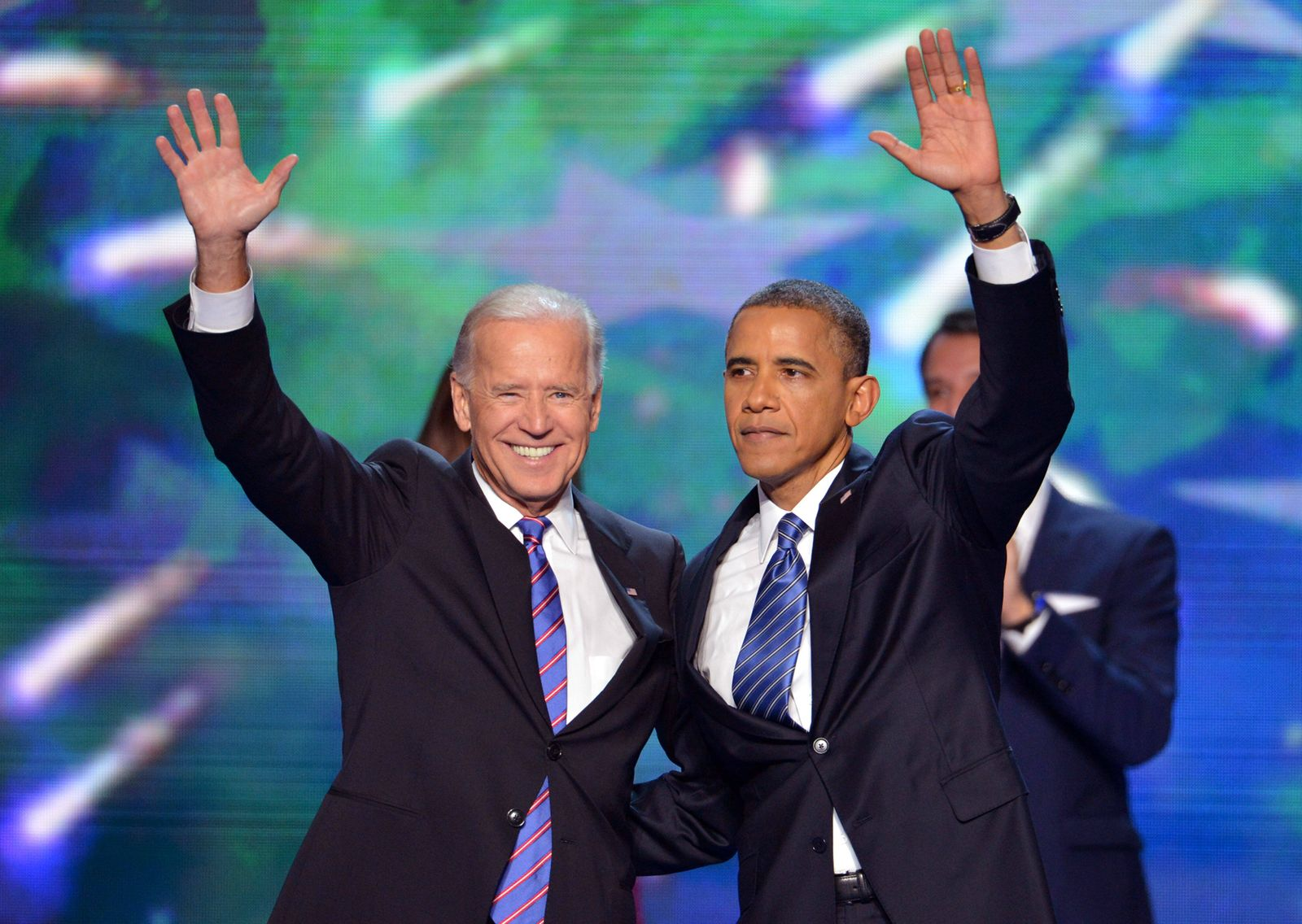 Former President Barack Obama waves and embraces his Vice President Joe Biden in this September 6, 2012 file photo durin