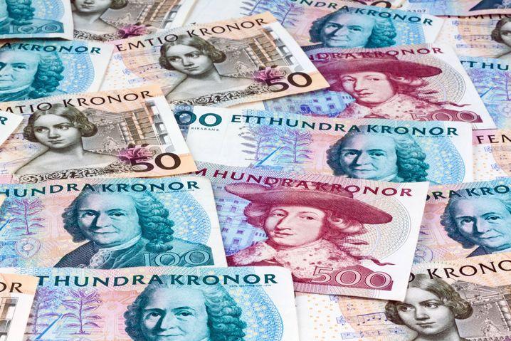 Bargeld lächelt: schwedische Kronen-Scheine