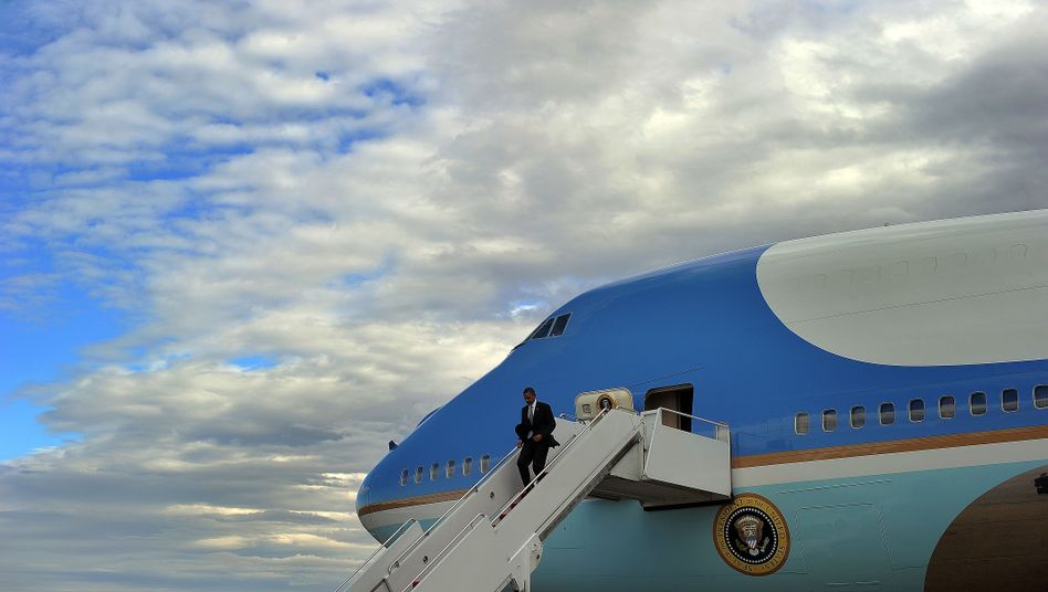"""Obama arriving at Andrews Airforce Base last week after a five-state trip. Obama and his advisers """"are obviously part of the 1 percent,"""" argues Fukuyama."""