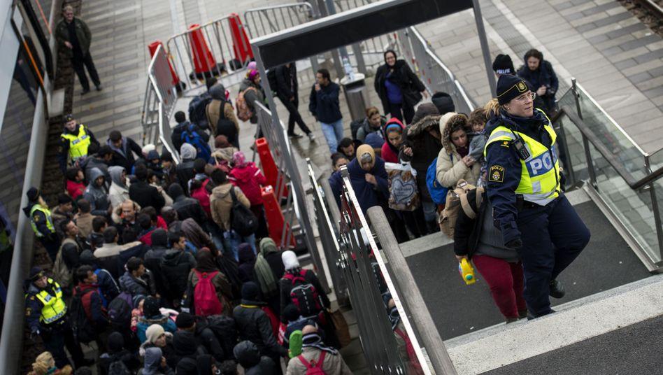Flüchtlinge bei der Ankunft in Malmö: Die Regierung reagiert auf den Andrang.
