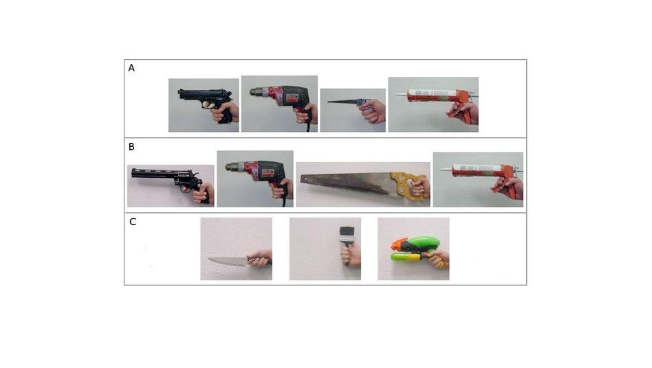 Fotos von Händen mit Gegenständen: Träger der Pistole größer und stärker geschätzt