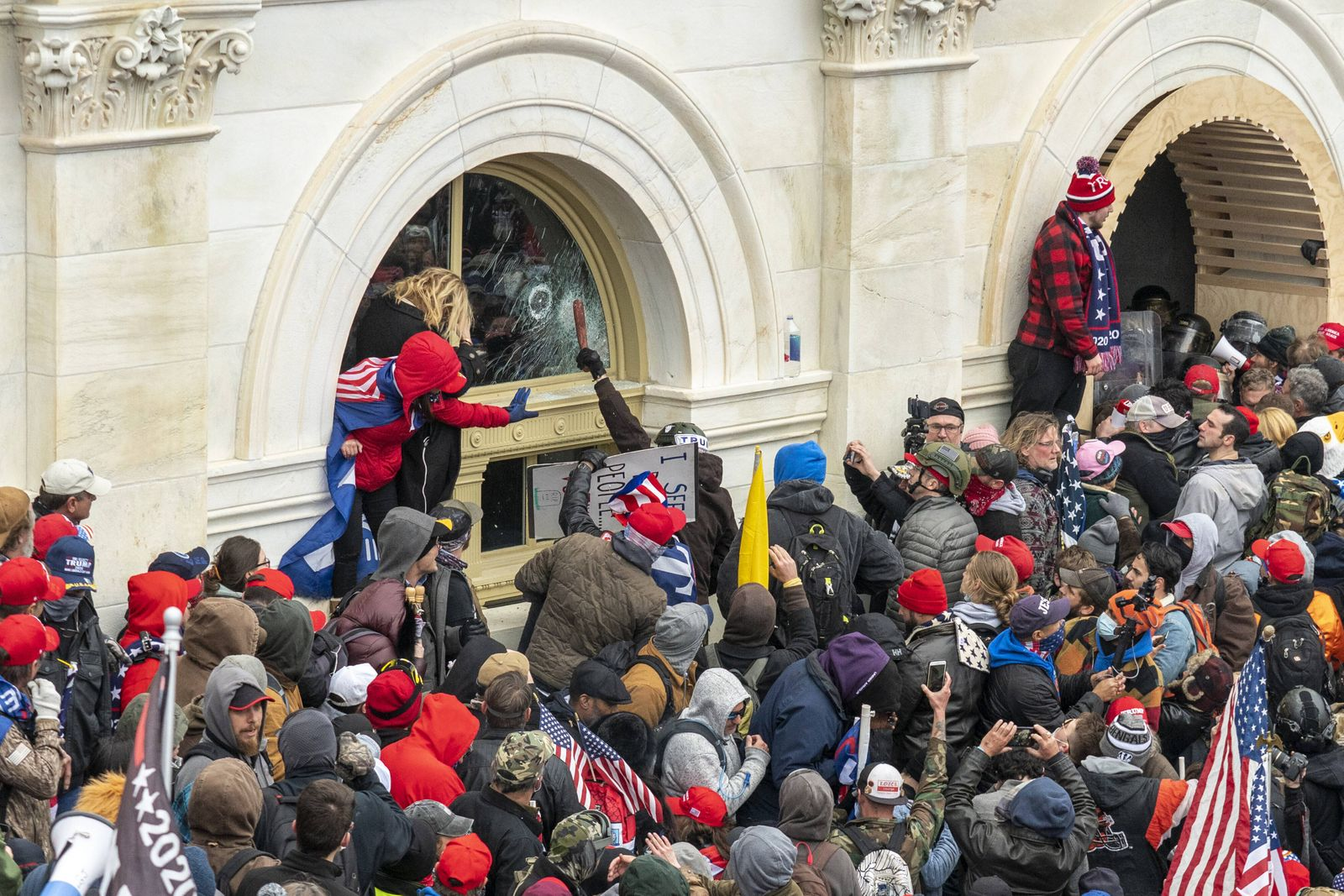 Pro-Trump rioters breach the security perimeter and penetrate the U.S. Capitol to protest against the Electoral College