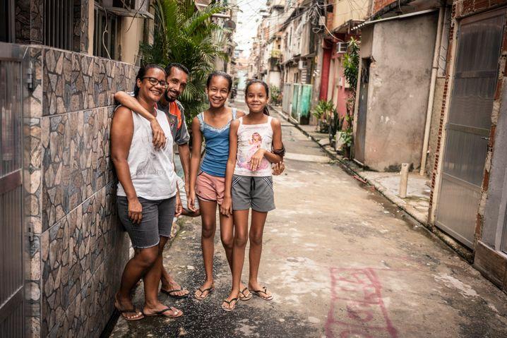 The Pereira Bernardo Ferreira family in front of their home in a Rio de Janeiro favela