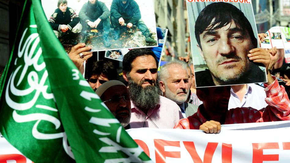 Chechen exiles demonstrate near the Russian consulate in Istanbul on Sept. 24, following the recent murder of three Chechen terror suspects in the city.