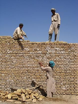 Workers build a school in the northern Afghan province of Saripul as part of a project funded by Welthungerhilfe, the German NGO.