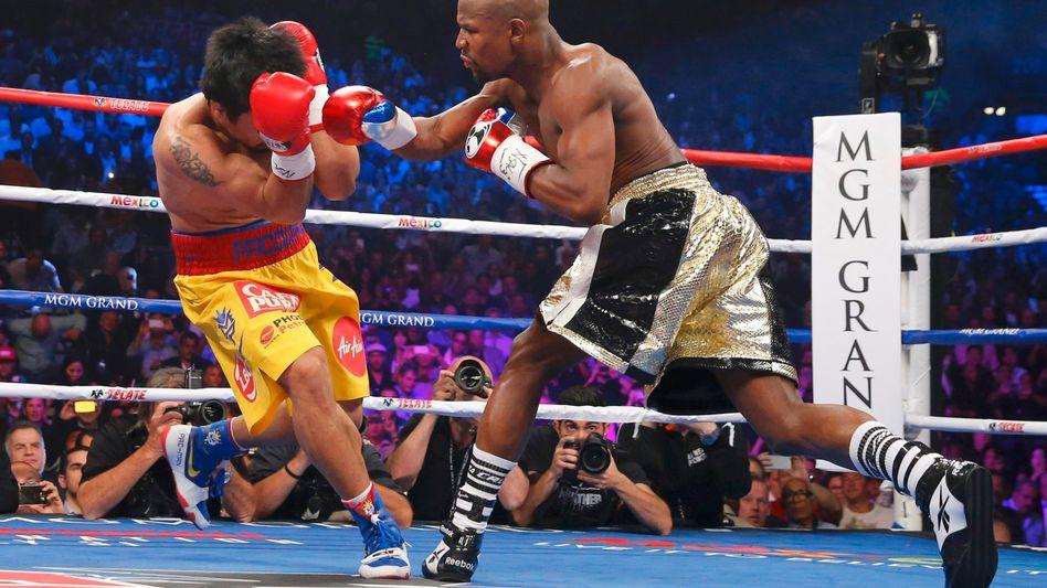 Manny Pacquiao (l.) gegen Floyd Mayweather: Ein Kampf, der Millionen Internetnutzer interessierte