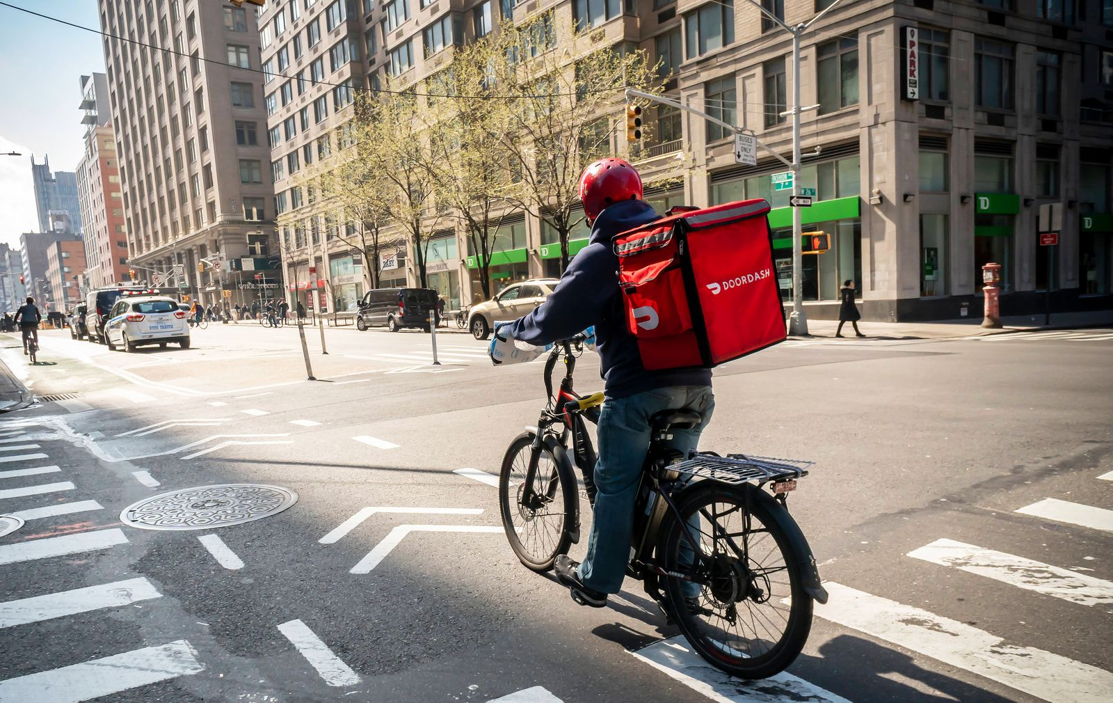 DoorDash internet based delivery service A delivery person with a DoorDash branded tote on his bicycle in the Chelsea ne