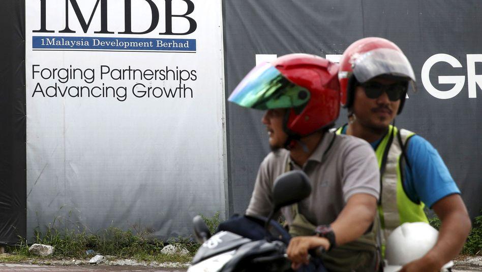 Plakat des malaysischen Entwicklungsfonds 1MDB