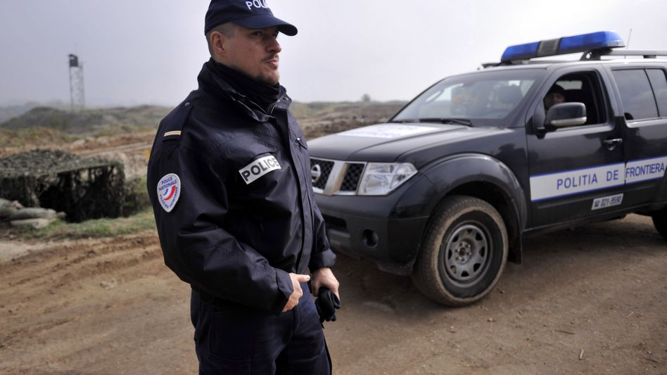 A police officer with the European border protection agency Frontex stands near the frontier between Greece and Turkey in November.