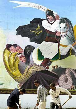 Sieben von zehn Amerikanern glauben an Saddams Verwicklung in den 11. September: Wandbild im Irak (Archiv)