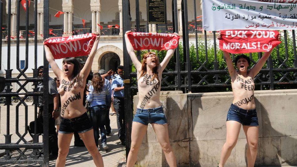 Femen activists protest the arrest of fellow Tunisian activist Amina Tyler in front of the Justice Ministry in Tunis.