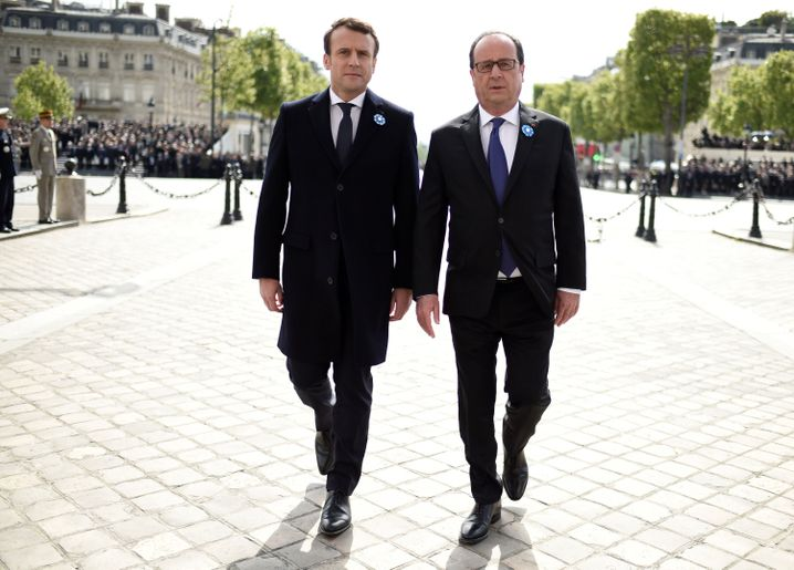 Macron is pictured with outgoing French President François Hollande on May 8