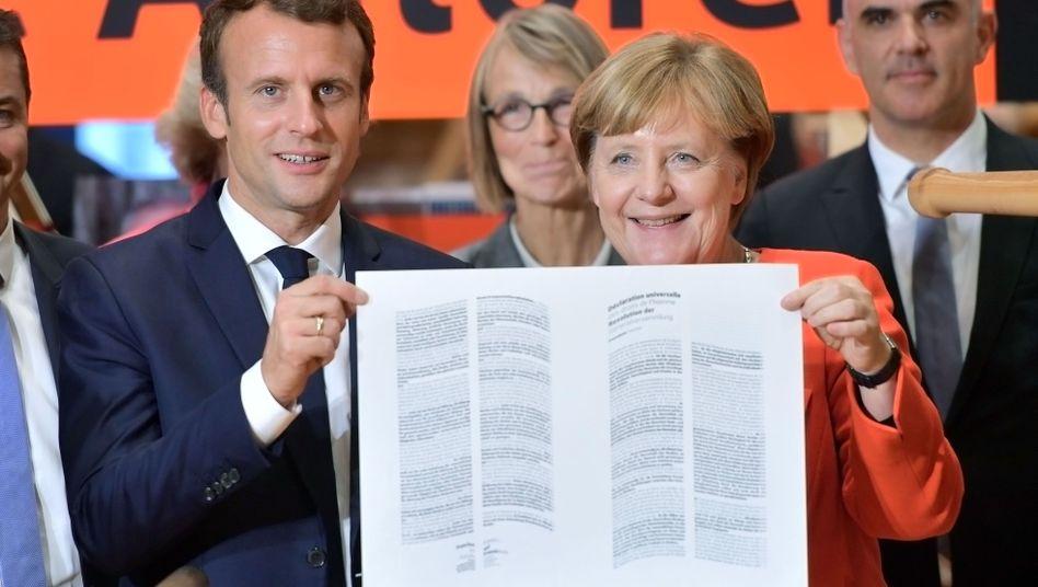 Angela Merkel und Emmanuel Macron auf der Frankfurter Buchmesse