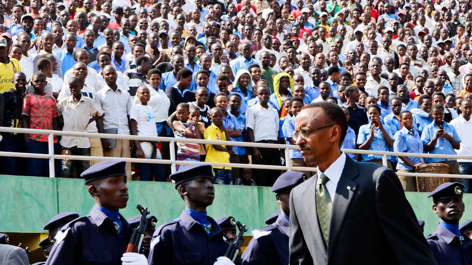 Rwandan President Paul Kagame reviews troops at Amahoro Stadium in Kigali during the Liberation Day ceremonies marking the 16th anniversary of the end of the 1994 genocide.