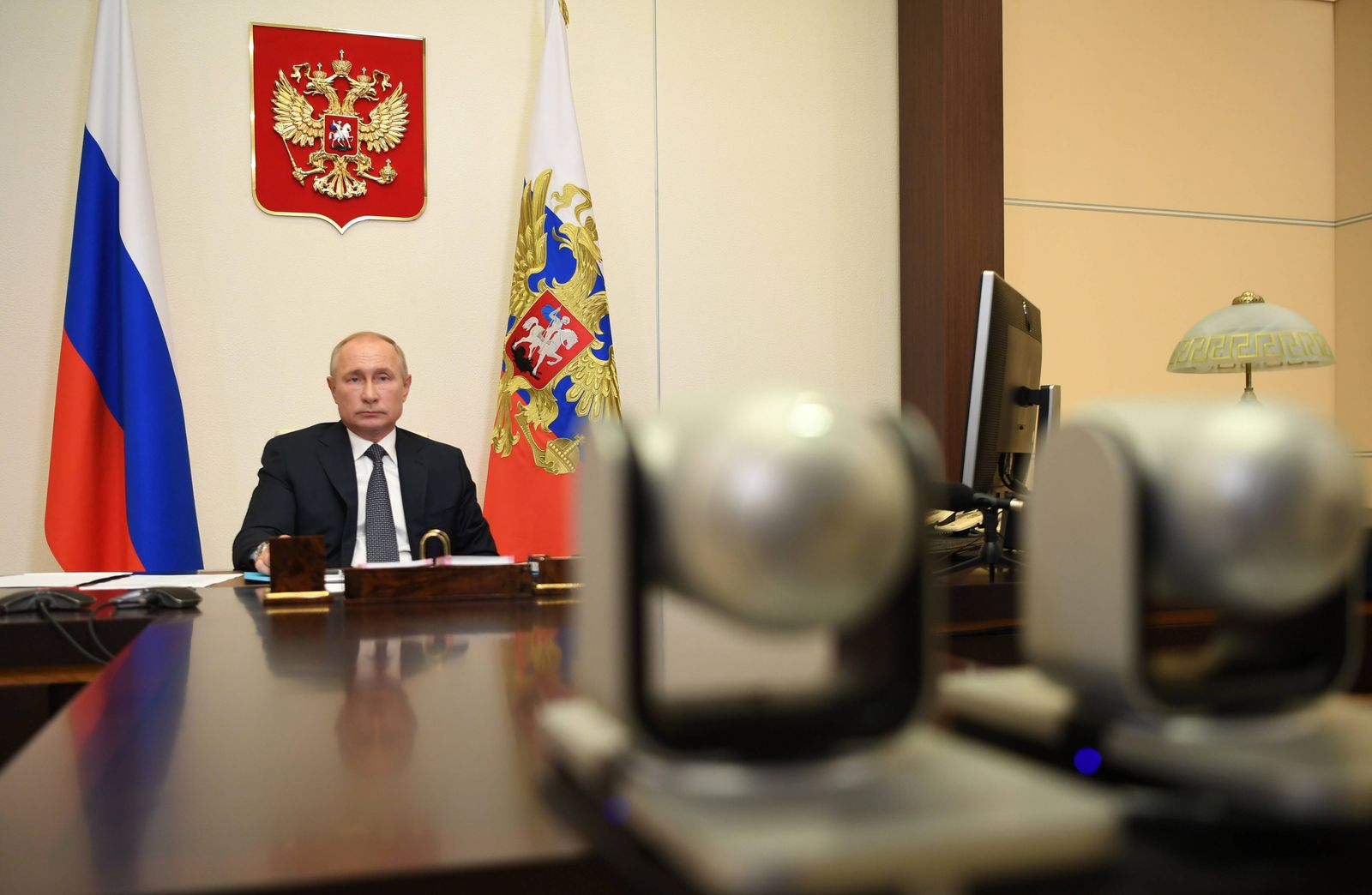 MOSCOW REGION, RUSSIA - AUGUST 11, 2020: Russia s President Vladimir Putin during a video conference meeting with membe