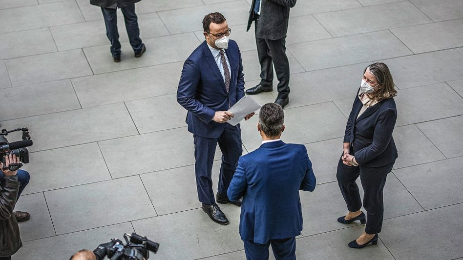 German Health Minister Jens Spahn (left) and Lothar Wieler (right), the head of the Robert Koch Institute, Germany's center for disease control, at a press event in Berlin