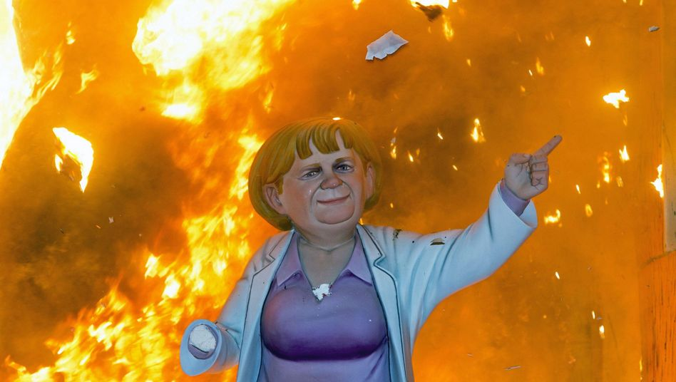 Will a strengthened hand allow Chancellor Merkel escape her bad rep? Here, a wooden sculpture of her is burned in Valencia, Spain, in March 2013.