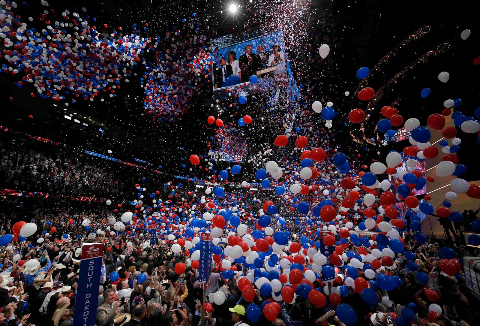 Balloons drop after U.S. Republican presidential nominee Donald Trump's speech with his family seen on screen at the Republican National Convention in Cleveland