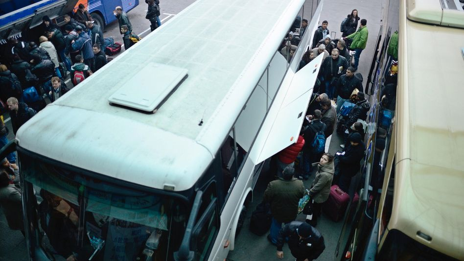 Passengers put their luggage onto a bus departing for Western Europe at the central bus station in Sofia, Bulgaria on Jan. 2.