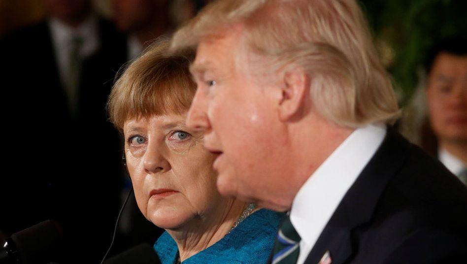 Angela Merkel (l.), Donald Trump (Archivbild)