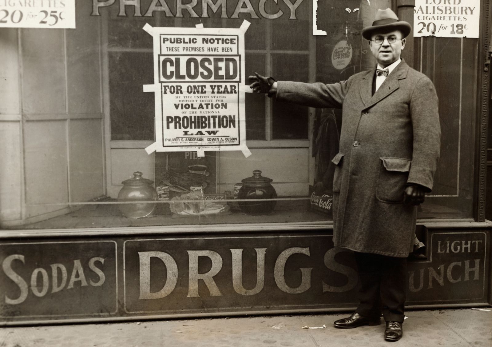 Prohibition - Man Points to Prohibition Sign