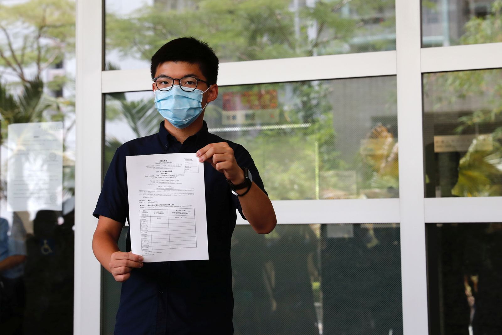 Pro-democracy activist Joshua Wong registers as a candidate for the upcoming Legislative Council election in Hong Kong