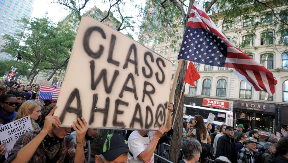 Protesters march in New York on Oct. 5, protesting bank bailouts and high unemployment.