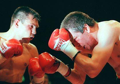 Boxer Michalczewski (l.), Rocchigiani (2000): Drittes Duell