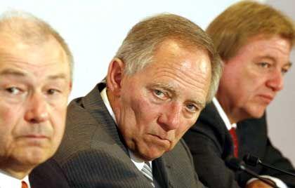 Innenminster Beckstein, Schäuble und Bouffier: Einigung um Mitternacht
