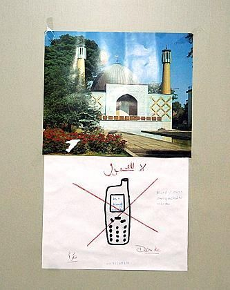 No cell phones in the mosque: A sign in a student dorm in Kiel, where one of the suspected train bombers lived.