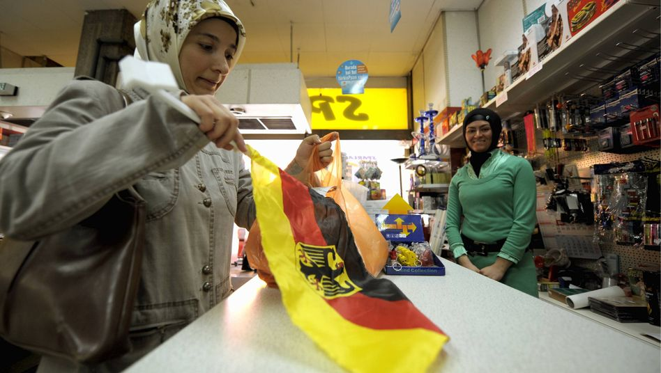 A Turkish girl buys a German flag in the run-up to a soccer match.